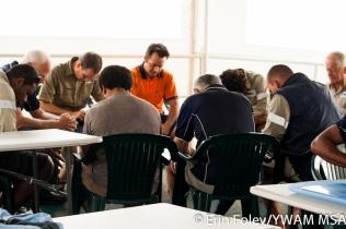 Ship crew prayer time.